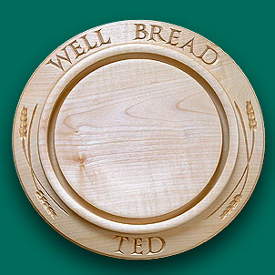 """well bread Ted"" inscribed bread board."