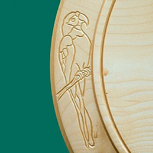 Closeup Parrot engraving French ski chalet cheese board